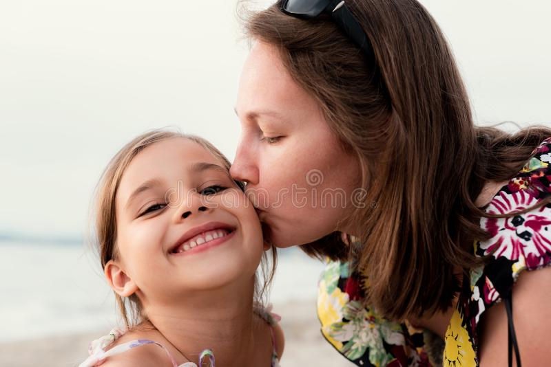 Portrait Of Mother and Daughter Outdoors at Beach in Summer Season royalty free stock images