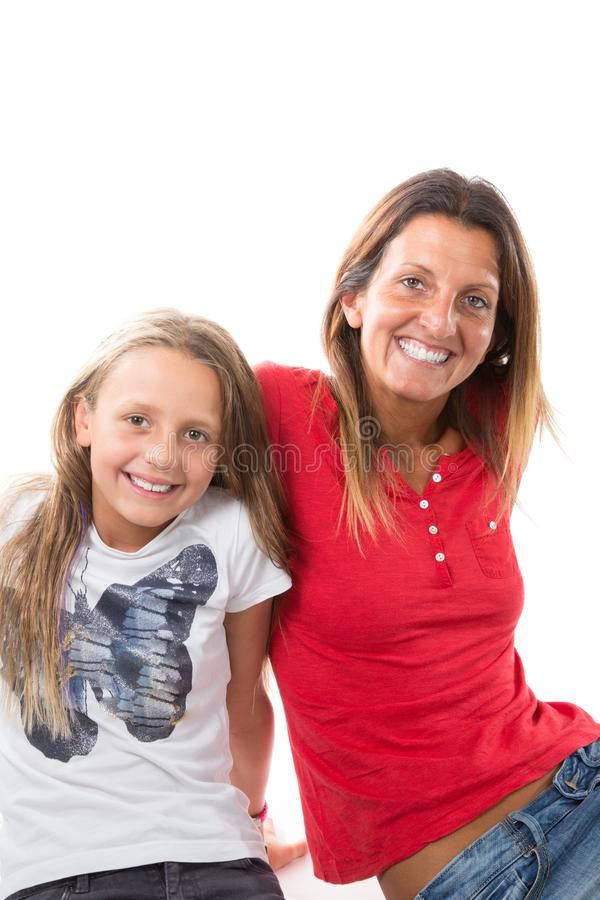 Portrait of happy mother and daughter sit on floor studio shot isolated on white background royalty free stock image