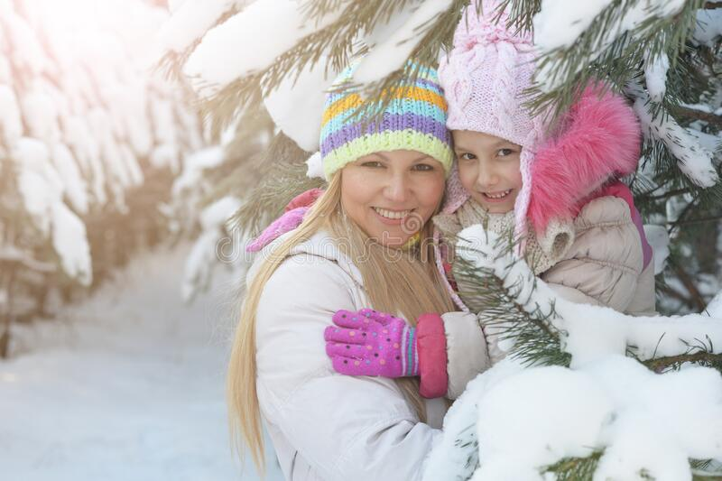 Portrait of a happy mother and daughter in winter royalty free stock images