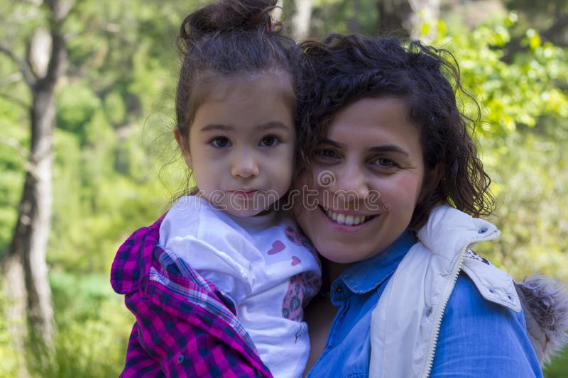 Portrait of happy mother and doughter in the park royalty free stock photos