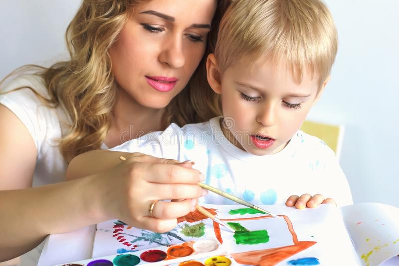 Portrait of a happy mother and her young son. mother and little stock photo