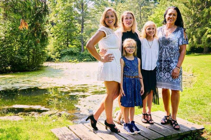 Portrait of happy mother posing with daughters stock images