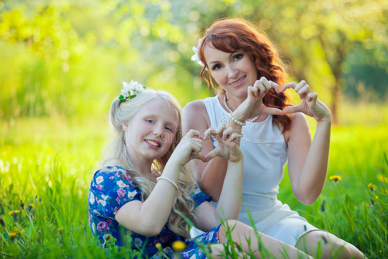 Portrait of happy mother and young daughter with stock images
