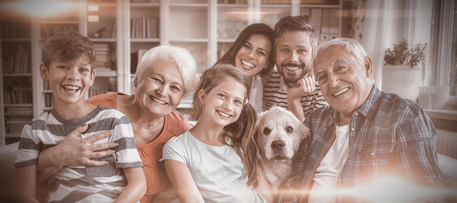 Portrait of happy multi generation family sitting on sofa in living room royalty free stock images