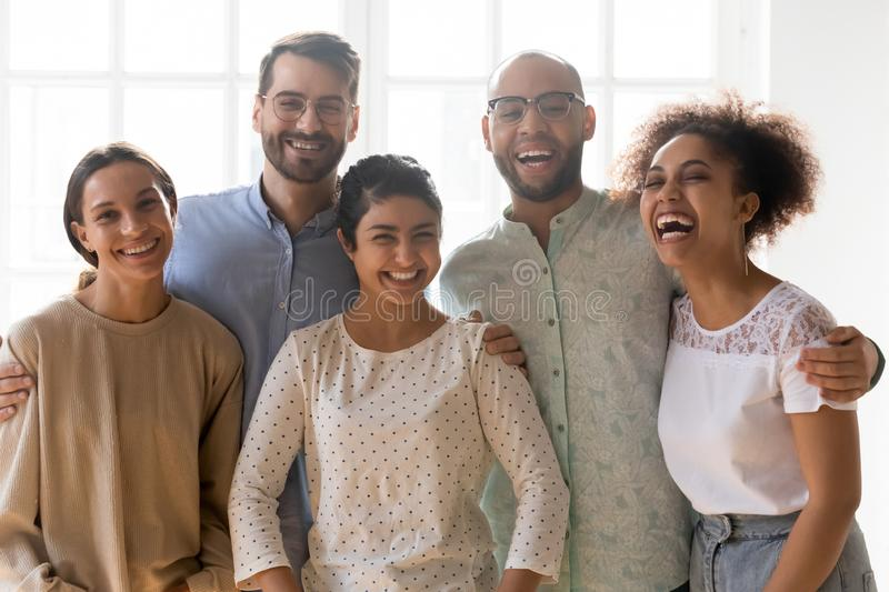 Portrait of happy multiethnic friends posing for photo royalty free stock images