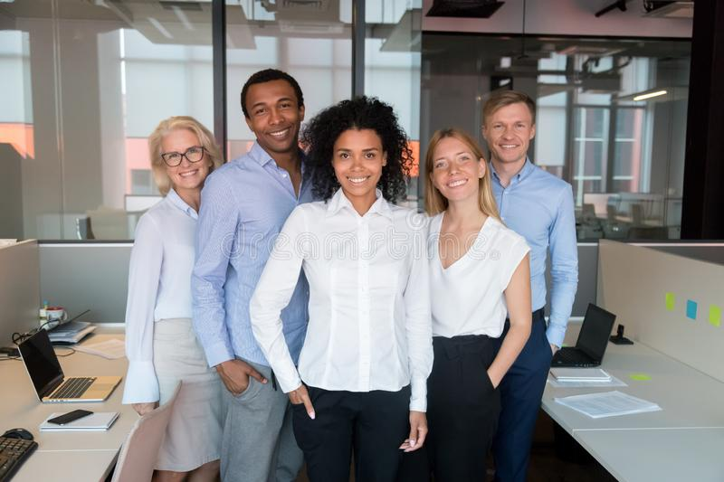 Portrait of smiling diverse employee look at camera making picture royalty free stock images