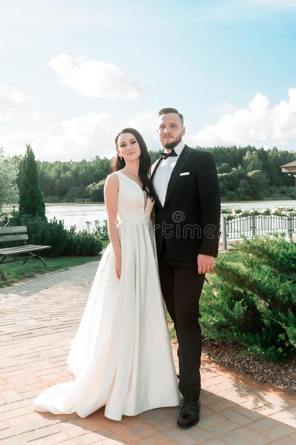 Portrait of happy newlyweds in the city Park royalty free stock image