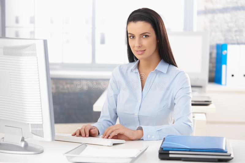 Portrait of happy office worker royalty free stock photography