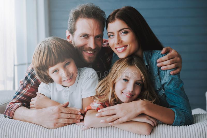 Portrait of happy parents with lovely children. Full healthy families concept. Joyful parents spend leisure time with children royalty free stock photos