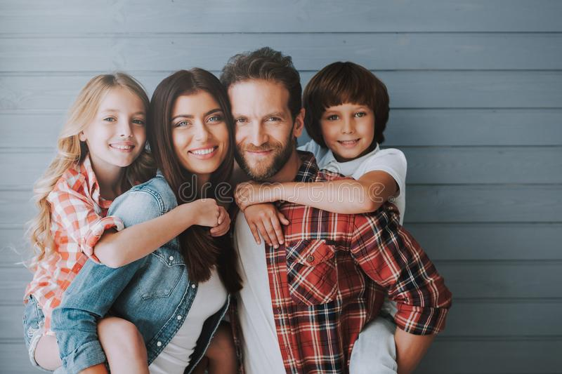 Portrait of happy parents with lovely children. Full healthy families concept. Joyful parents spend leisure time with children stock photography