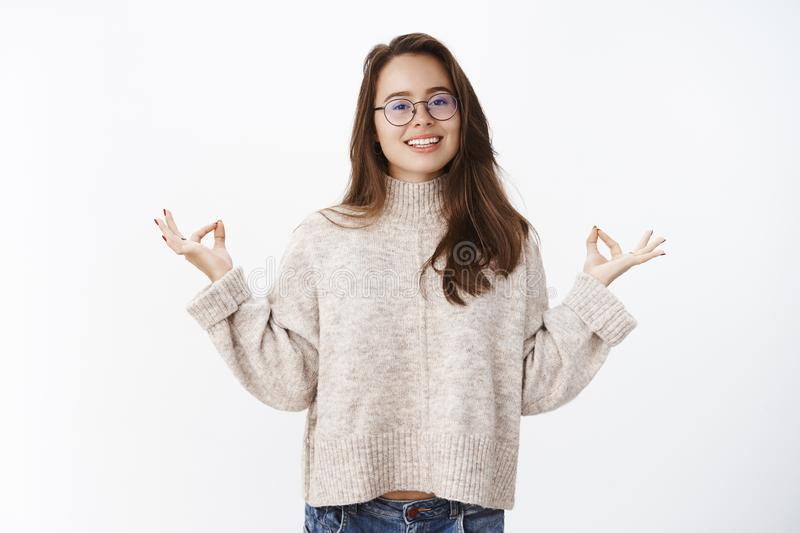 Portrait of happy peaceful good-looking woman in glasses and warm sweater keep calm as meditating smiling broadly at stock images