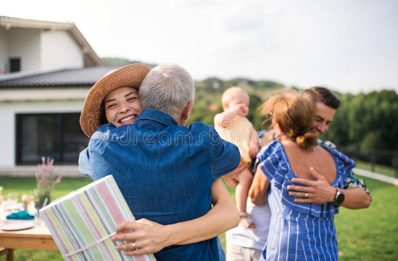 Portrait of happy people outdoors on family birthday party. royalty free stock photo