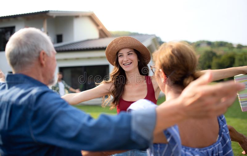 Portrait of happy people outdoors on family birthday party, greting. royalty free stock image