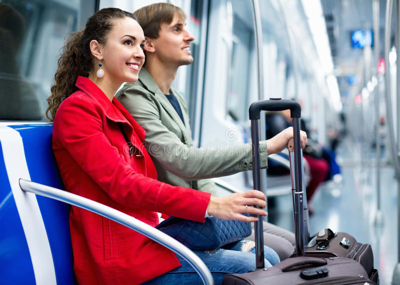 Portrait of happy positive metro passengers sitting in car seats stock photos