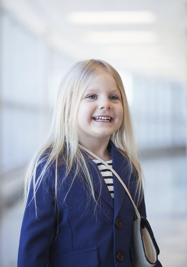 Portrait of happy preschool little girl wearing blue jacket stock images