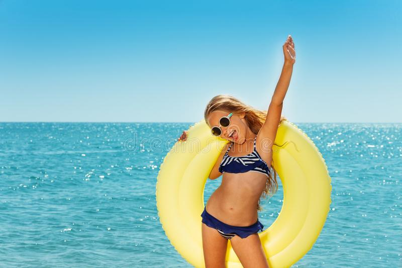 Happy preteen girl enjoying summer by the seaside royalty free stock image