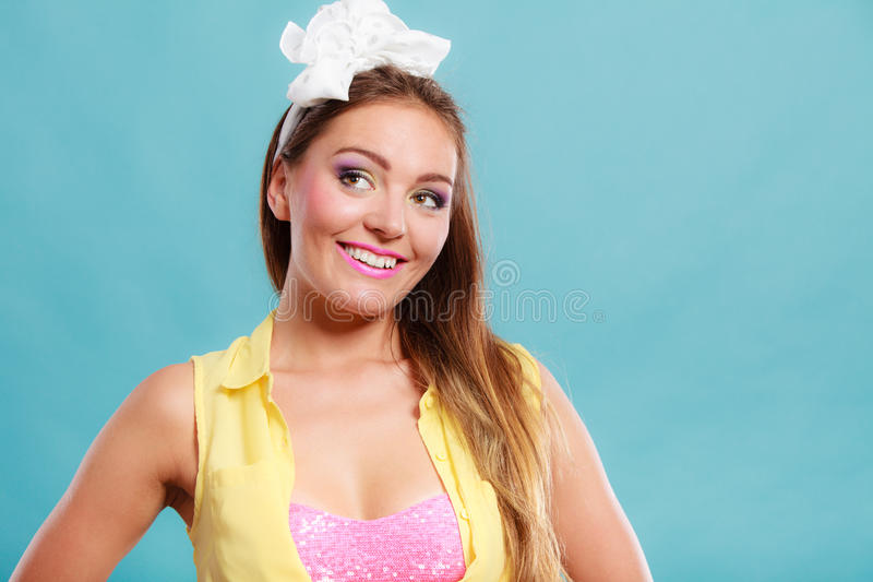 Portrait of happy pretty pin up girl with bow. royalty free stock photos