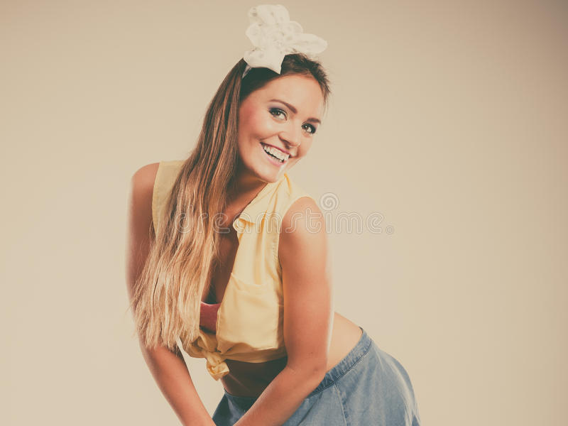 Portrait of happy pretty pin up girl with bow. stock photography