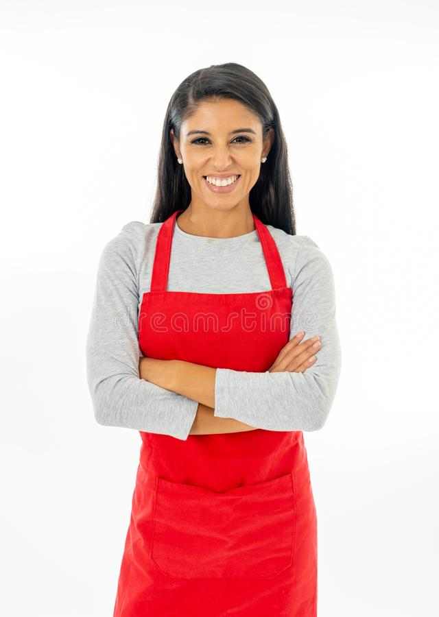 Portrait of a happy proud beautiful latin woman wearing a red apron learning to cook making thumb up gesture in cooking classes stock photos
