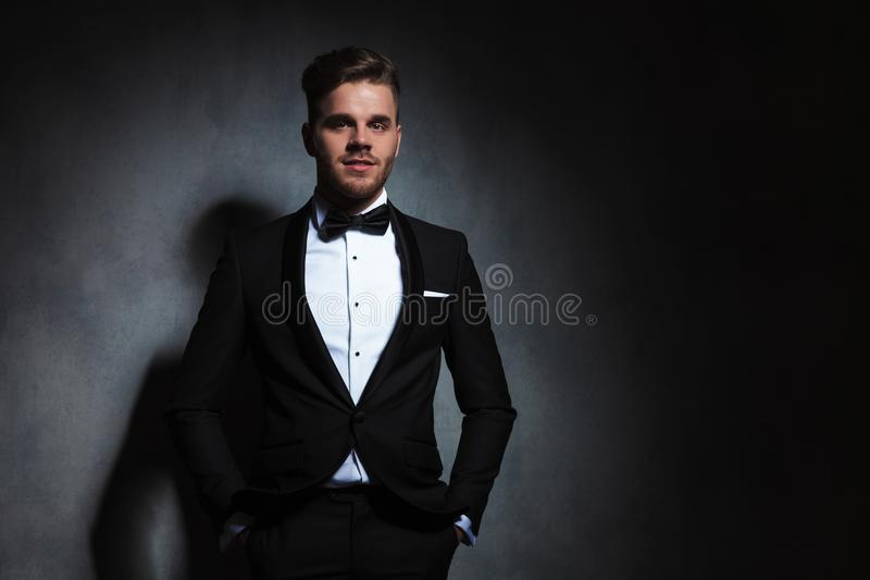 Portrait Of Happy And Relaxed Young Man In Black Tuxedo