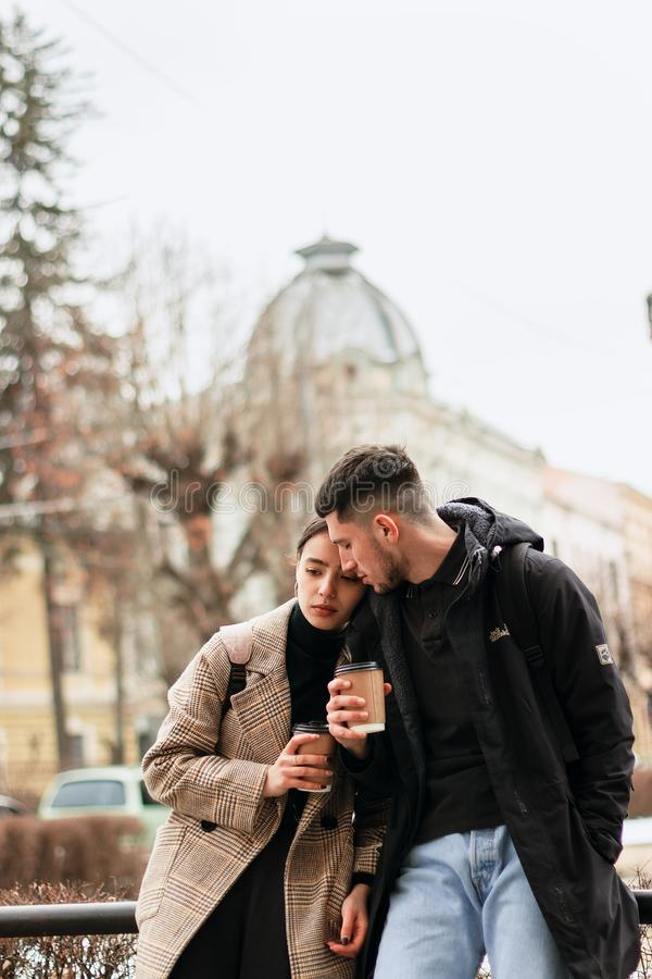 Portrait of a happy romantic couple having rest with cofee stock photos