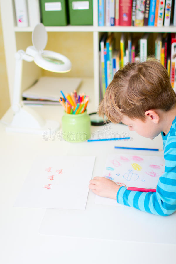 Portrait Of Happy Schoolboy At Home Stock Images