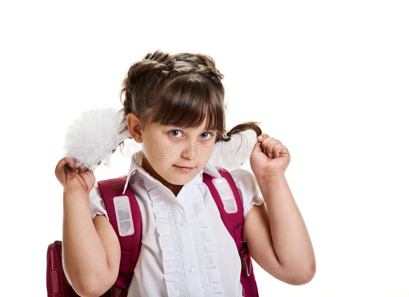 Schoolgirl showing hairstyle stock photo
