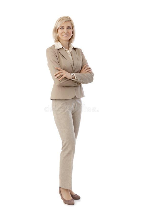 Portrait of happy secretary in beige suit royalty free stock image