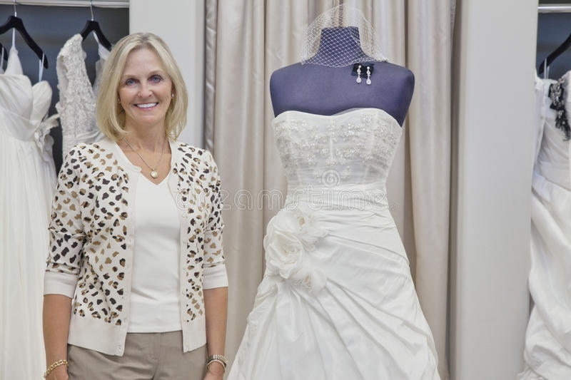 Portrait of a happy senior bridal store owner stock photography