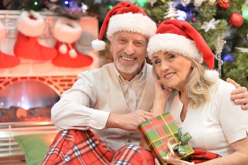 Portrait of a happy senior couple celebrating Christmas stock images