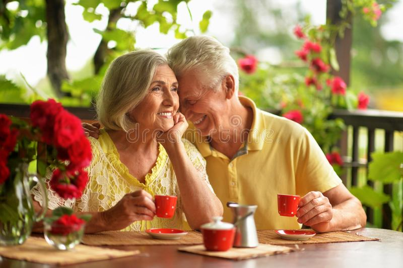 Portrait of happy senior couple drinking coffee stock photos