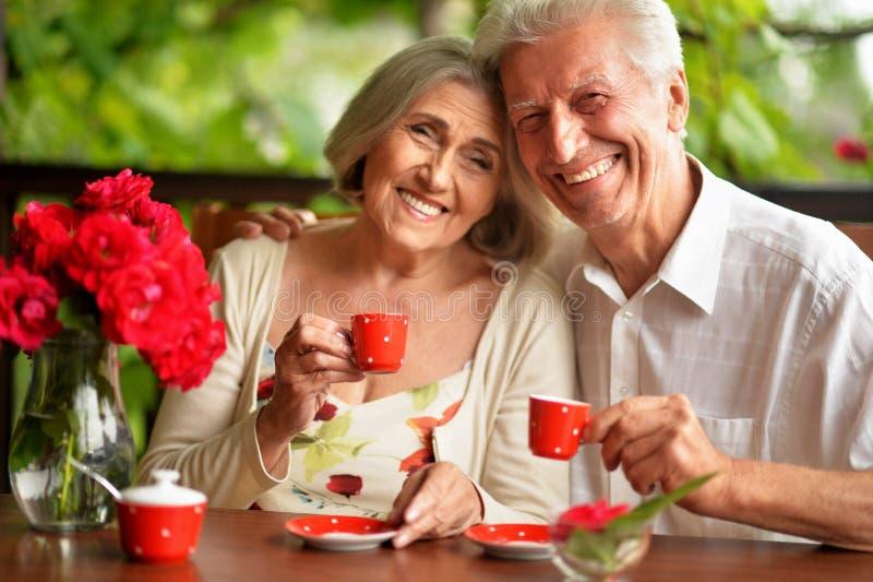 Portrait of happy senior couple drinking coffee stock photo