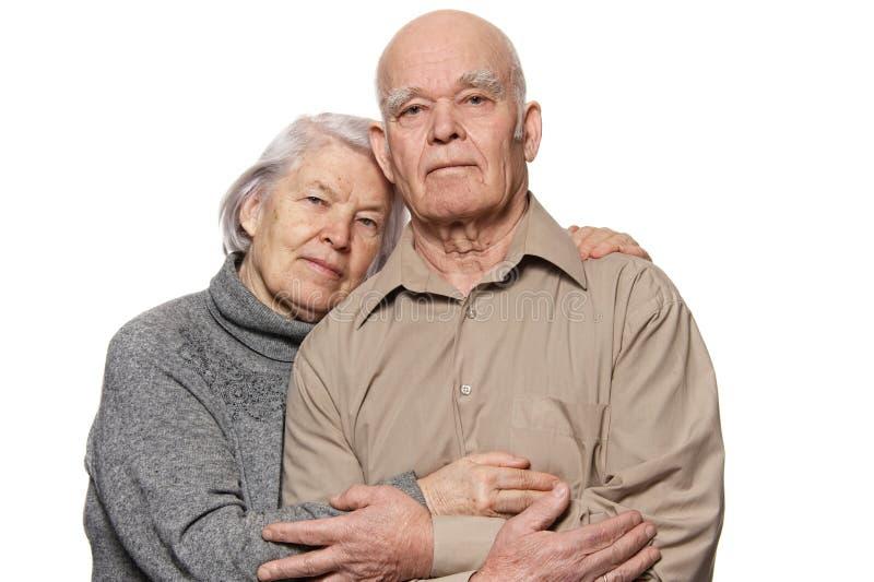 Portrait of a happy senior couple embracing stock images