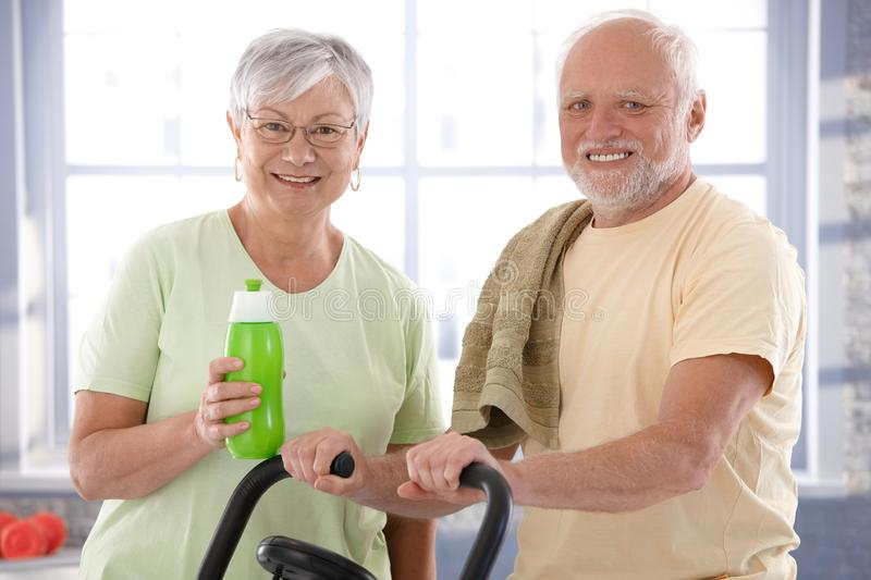 Portrait of happy senior couple in the gym royalty free stock image