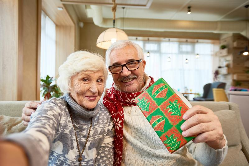 Senior Couple Taking Selfie on Christmas stock photos