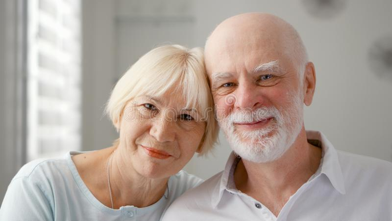 Portrait of happy senior couple at home. Emotional moment. Happy family enjoying time together. stock image