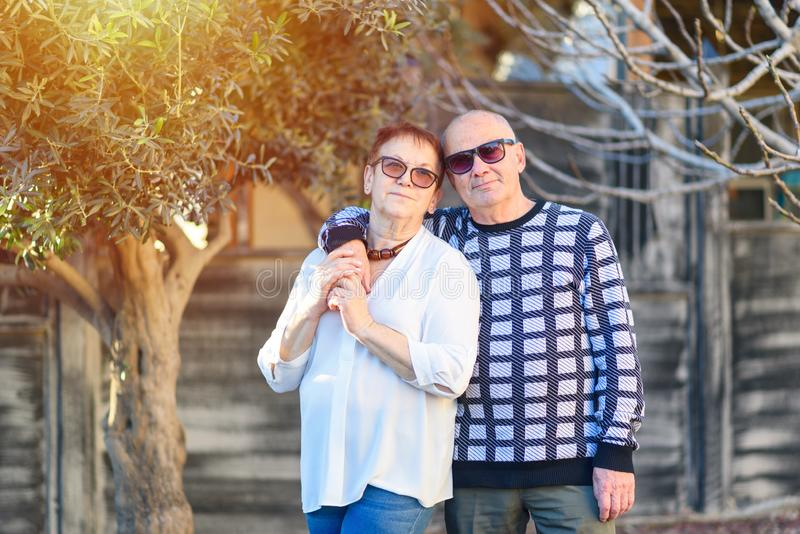 Senior couple relaxing by the park on sunny day. royalty free stock images