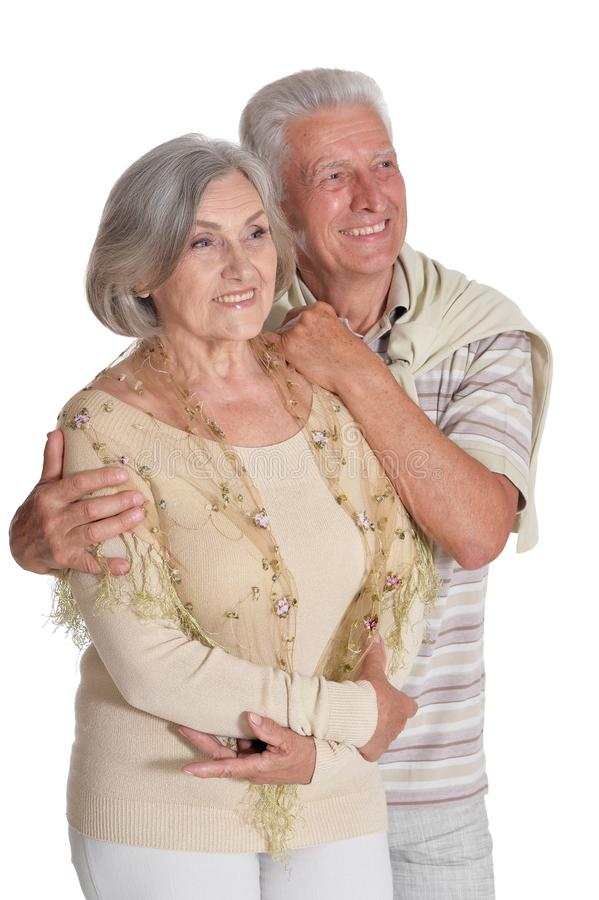 Portrait of happy senior couple hugging on white background royalty free stock images