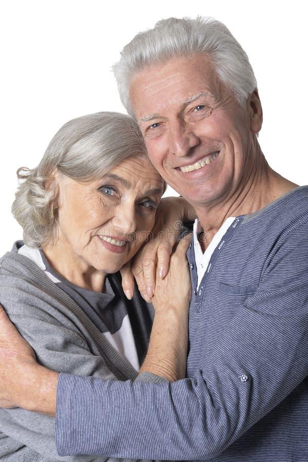 Close up portrait of happy senior couple. Portrait of happy senior couple isolated on white background stock photo