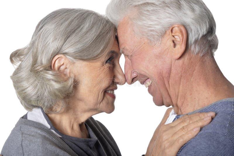 Close up portrait of happy senior couple. Portrait of happy senior couple isolated on white background stock photography