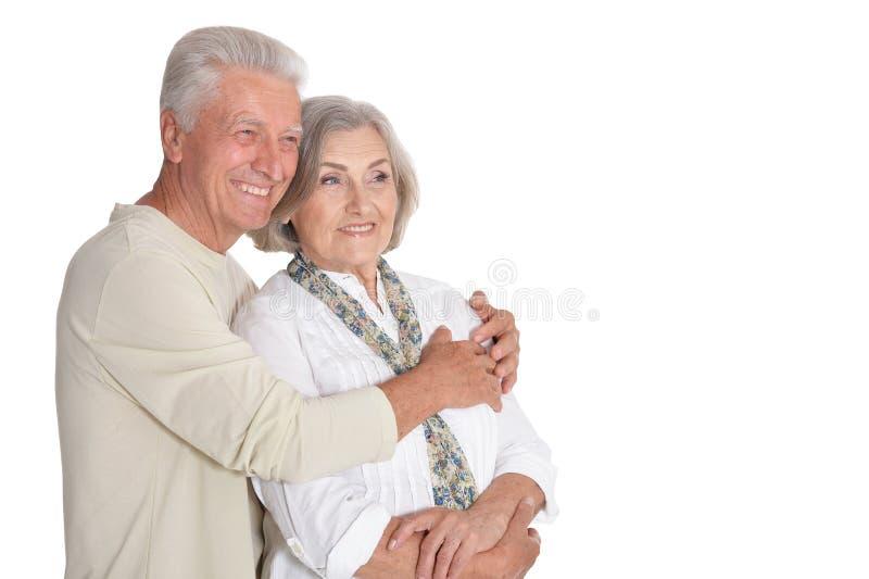 Portrait of happy senior couple posing on white background stock photos