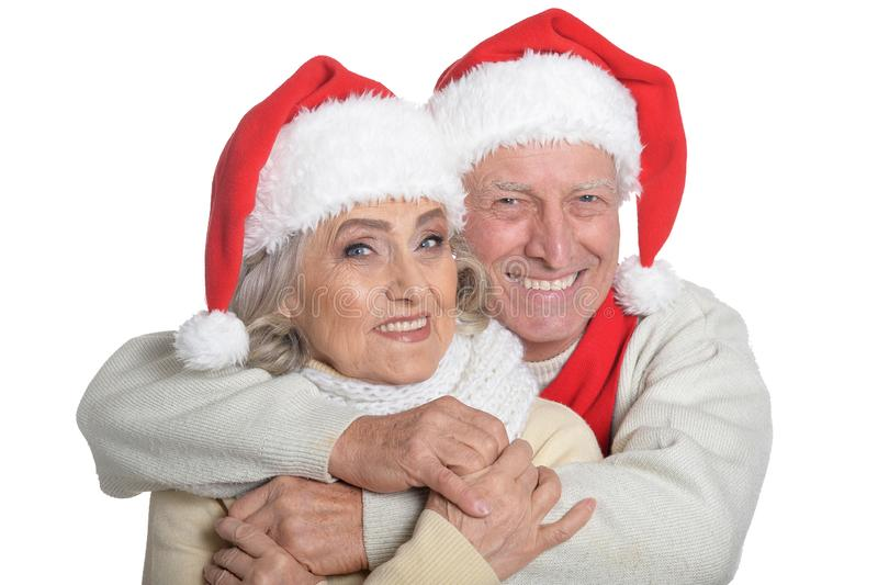 Portrait of happy senior couple in Santa hats stock photos