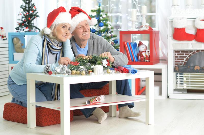 Portrait of happy senior couple in Santa hats royalty free stock photo