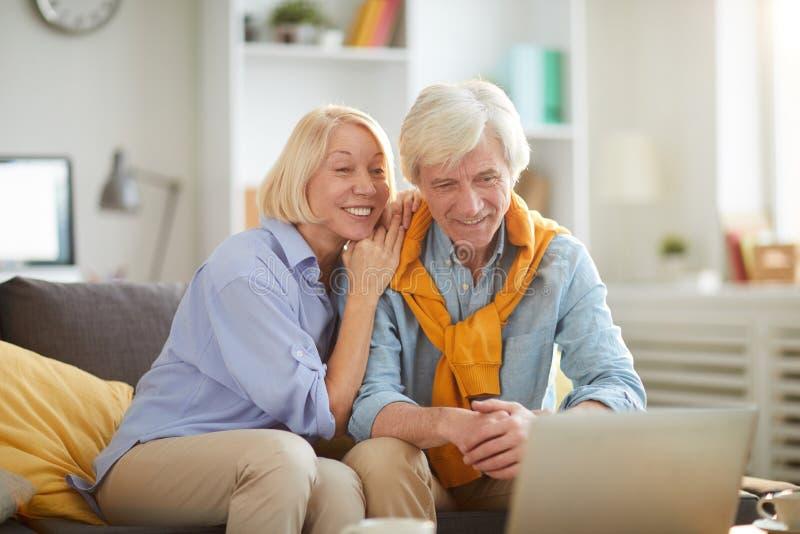 Smiling Senior Couple Using Laptop Together royalty free stock image