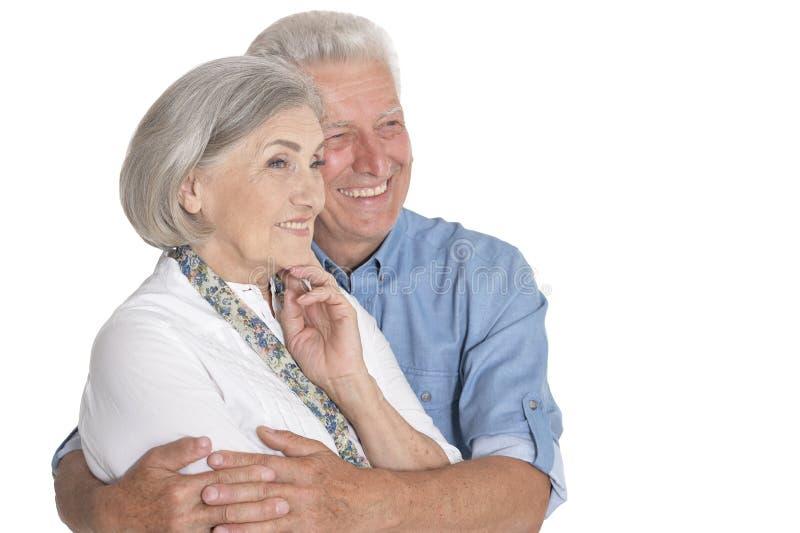 Portrait of happy senior couple on white background stock photography
