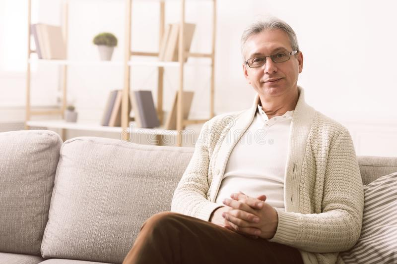 Portrait of happy senior man having rest at home royalty free stock images