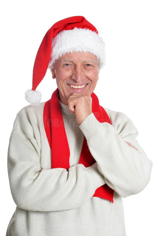 Portrait of happy senior man in Santa hat stock photo