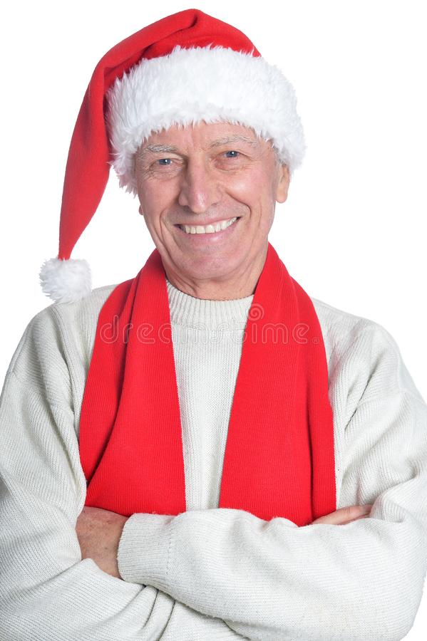 Portrait of happy senior man in Santa hat royalty free stock image