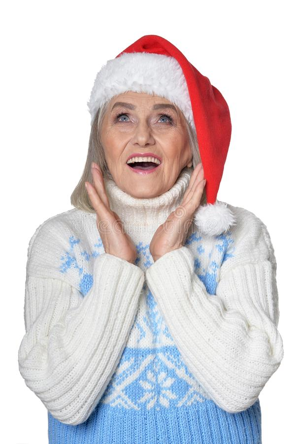 Portrait of happy senior woman in Santa hat stock images
