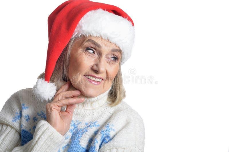 Portrait of happy senior woman in Santa hat royalty free stock photography